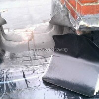 Rubber Roof Chimney Flashing Repair - Installing 12 inch corner patch