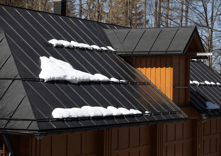 Raised seam metal roof with snow