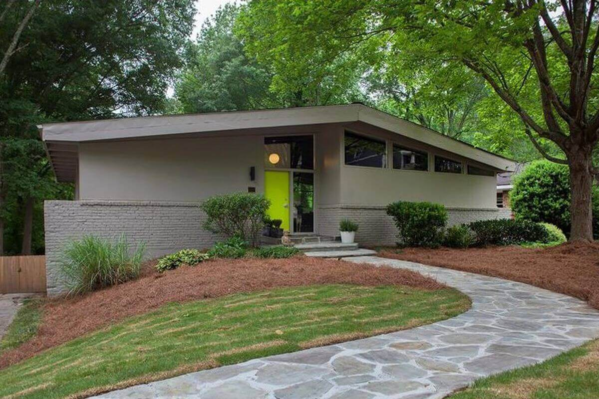 Classic Raised Ranch House with flat roof TPO material