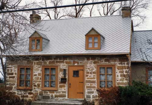Metal Shingles on a stone home