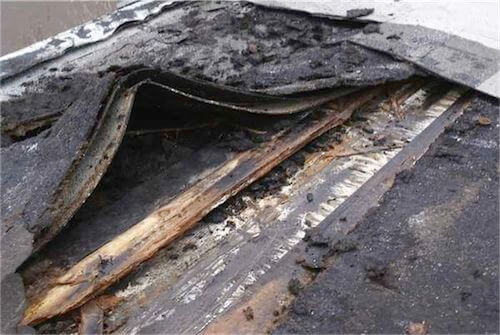Old, damaged flat roof