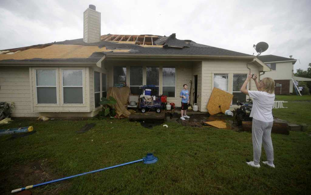 Shingles and plywood blown off the roof on a home in Houston TX by Hurricane Harvey